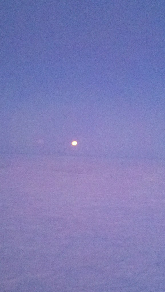 the moon from the plane